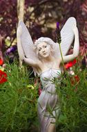 garden white statue of a fairy woman with wings