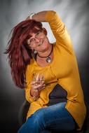 happy red haired funny Woman with Wine glass in hand