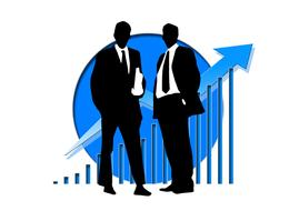 Silhouettes of businessmen on a background of blue krgua and a growing schedule