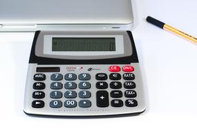 Calculator,pen and laptop