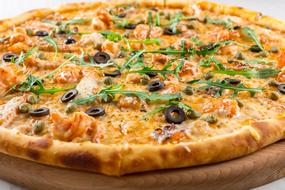 hot pizza with arugula and olives