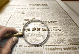 Newspaper Magnifying Glass text
