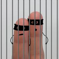 photo of two fingers in prison