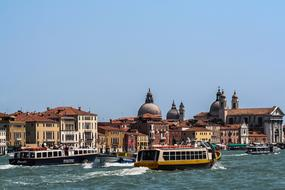 tourist boats on grand canal at landmarks, Italy, Venice