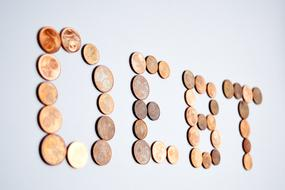 Debt word with Euro Coins