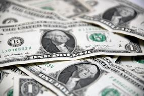 Photo of businessman on the background of falling dollars free image