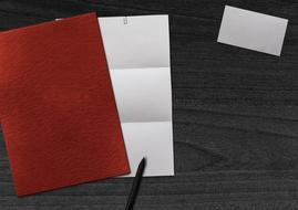 blank red and white sheets of Paper and Business Card on desk