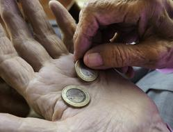 coins in hands of an old man