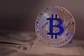 Bitcoin blue gold icon