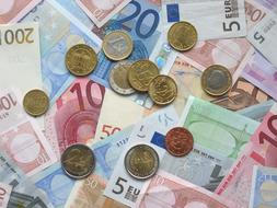 Euro Banknotes and Coins, flat lay