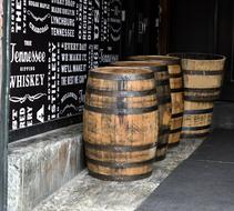 Whiskey Barrels at wall in pub