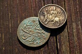 two antique indian coins
