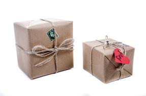 two Boxes with tags wrapped in Paper