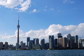 photo of the modern harbor and television tower in Toronto