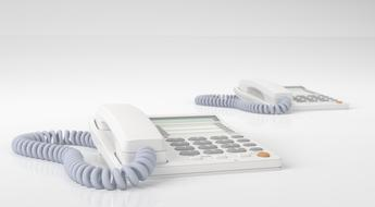 two white wired phones