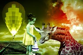 Girl caressing beautiful and cute giraffe at colorful background with a hot air balloon above the railway