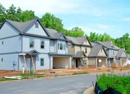 New suburban houses in row on roadside