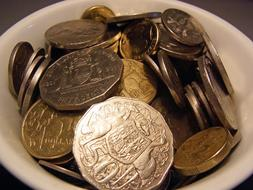 Australian coins in a white bowl