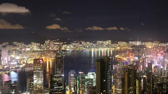 night Cityscape with high-rise Buildings at water, china, Hong Kong