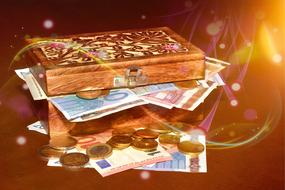 banknotes and coins in a wooden box