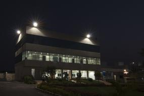Office building with windows and lights at night