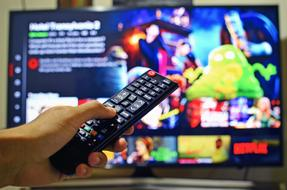 switch TV programs using the remote control