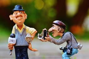 comic figure of a journalist and cameraman