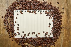 notebook and coffee beans