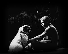 Friendship, man and Bulldog sitting together