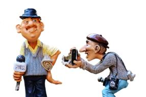 porcelain figurines of a reporter and photographer