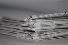 black and white photo of a stack of newspapers