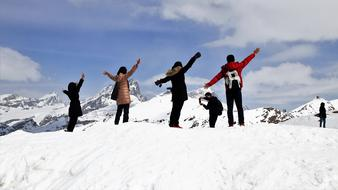 young people posing on Alps Tops at Winter