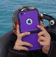 photo of a scuba diver with an iPhone in a waterproof case