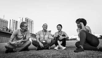 black and white photo of volunteers from different countries on the lawn