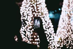 photo of christmas decoration on smartphone screen