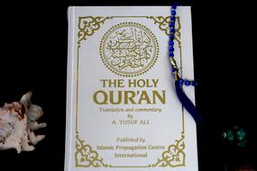 Holy Quran, beads on closed book
