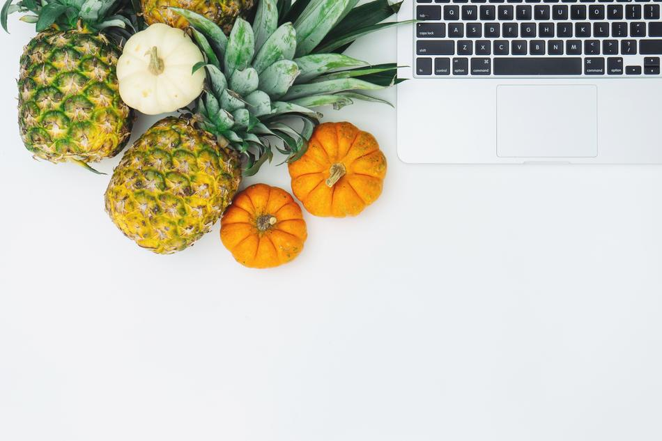 pineapples, pumpkins and laptop on the table