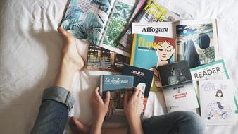 old magazines on the bed