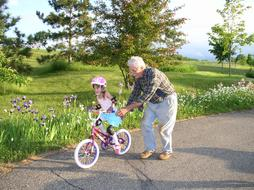 Grandparents and Bicycle Girl