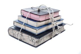 stack of books tied with rope