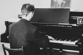 Pianist, young man playing, vintage photo
