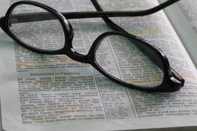 Teacher Word Bible and glasses