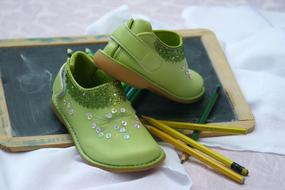 green Shoes and Board and Pens