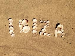 Ibiza, seashell word on sand