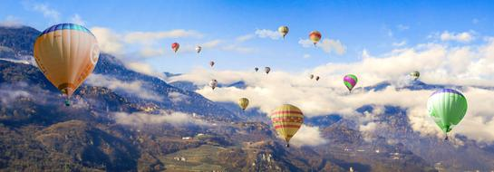journey on hot air balloons over the mountains in South Tyrol