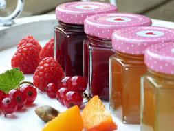 Jars with the colorful fruit jams