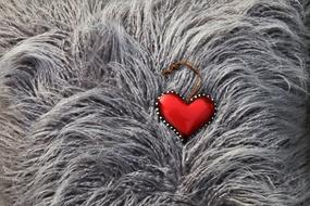 red Heart shape decoration on grey fur