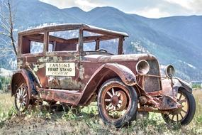 old rusty truck in a mountainous area