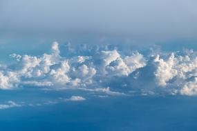 white cumulus clouds high in the sky