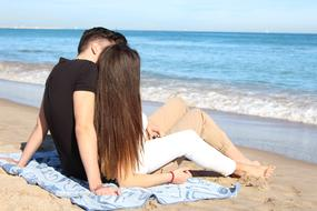 couple in love is resting on the ocean